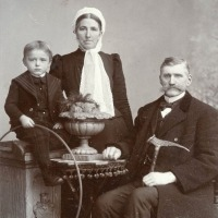 Couple with their grandson in Gnesen, Prussia (Gniezno, Poland)