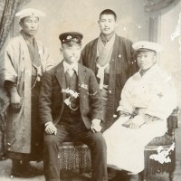 Four Japanese men in occupational clothing