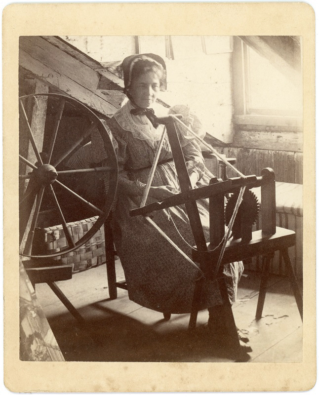 Woman at a spinner's weasel 3