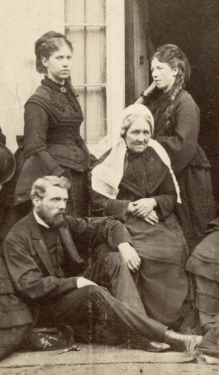 Group in dark clothes, possibly Scottish 3
