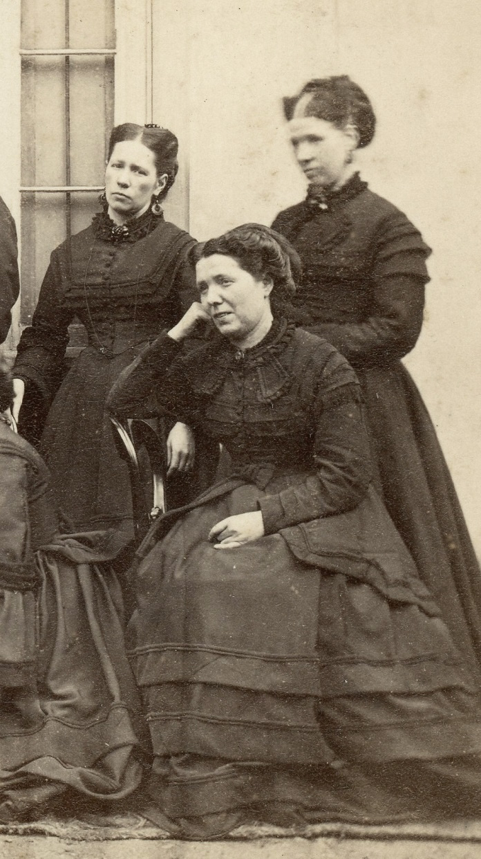 Group in dark clothes, possibly Scottish 5