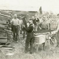 Cutting wood for a sauna near Bristol Bay, Alaska (1929)